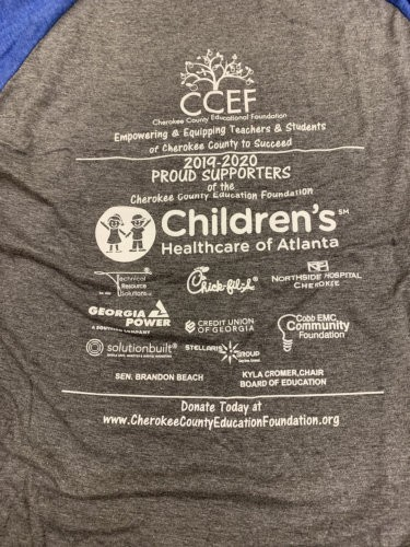 Back of t-shirt with sponsors displayed