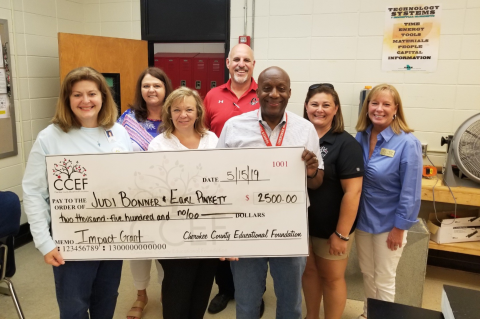 CCEF Board Members presenting a $2,500 check for an Impact Grant.